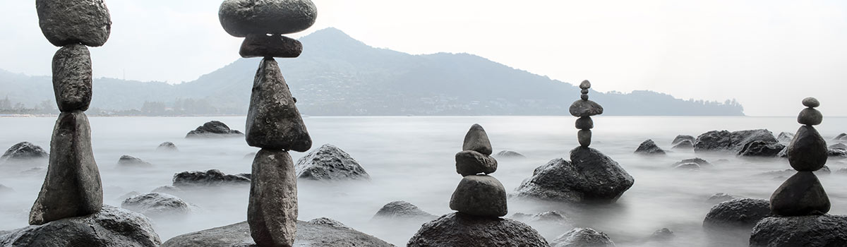 Rocks stacked by a lake